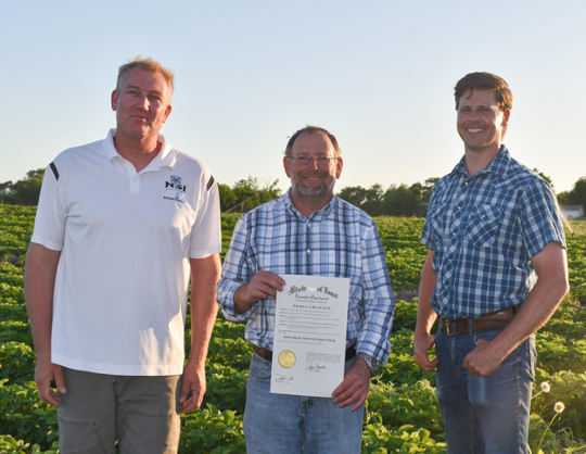 Pictured here is the Iowa Fruit and Vegetable Grower's Association board with Governor Kim Reynold's proclamation.