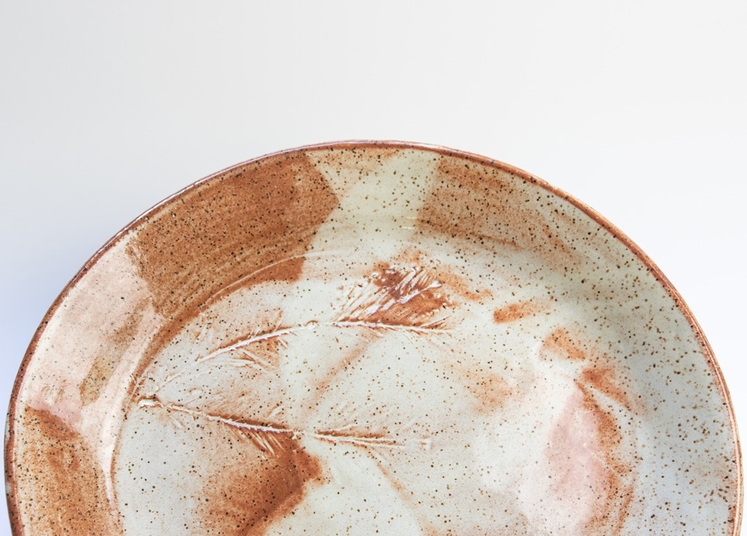 Learn handbuilding techniques like slab and coil building to create two pieces of bakeware, a casserole dish and a pizza stone.