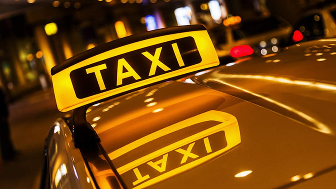 Company logo of P-Town Taxi Service